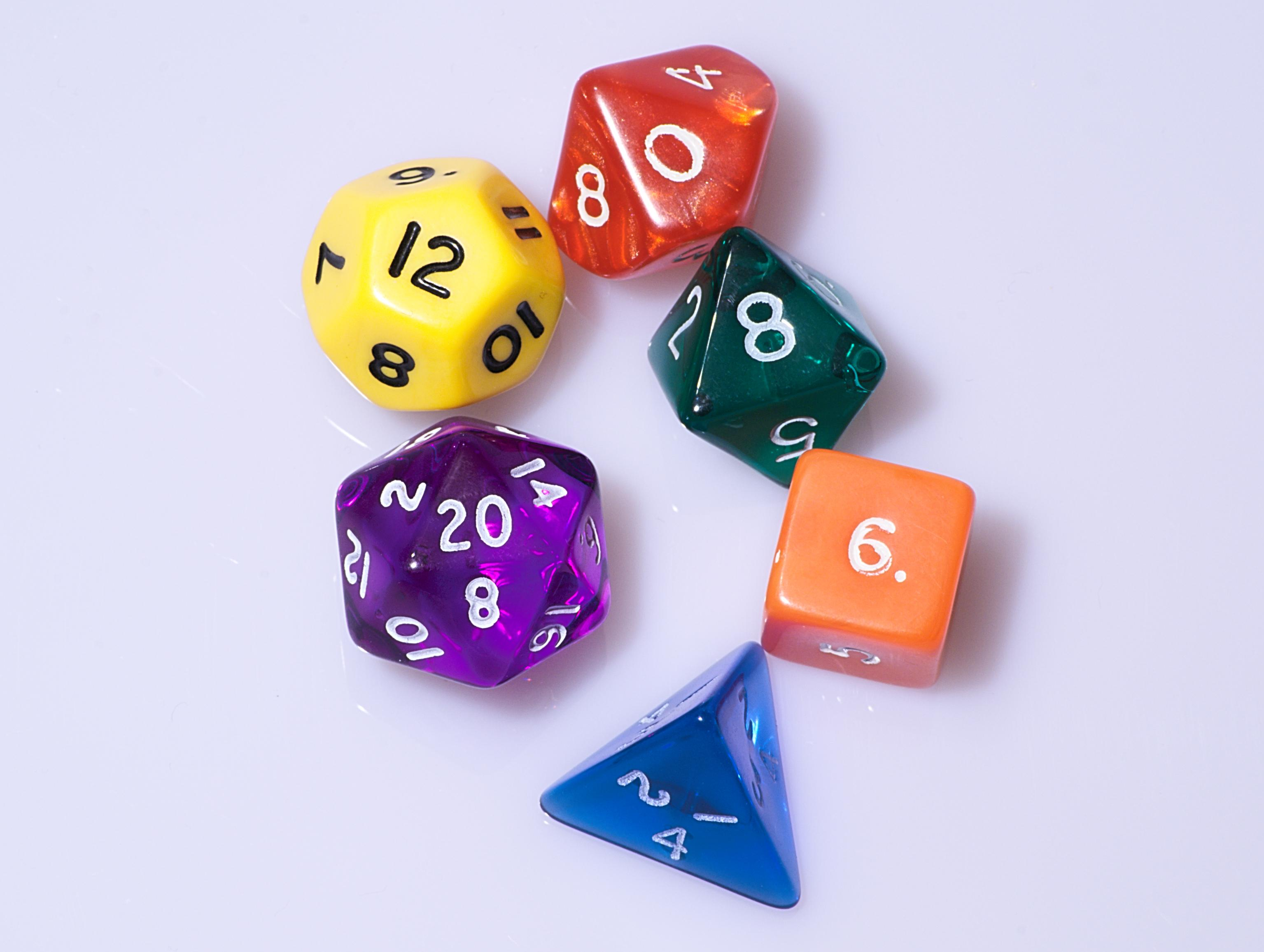 a group of multi-colored polyhedral dice
