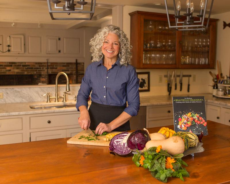 woman with curly hair in kitchen chopping vegetables