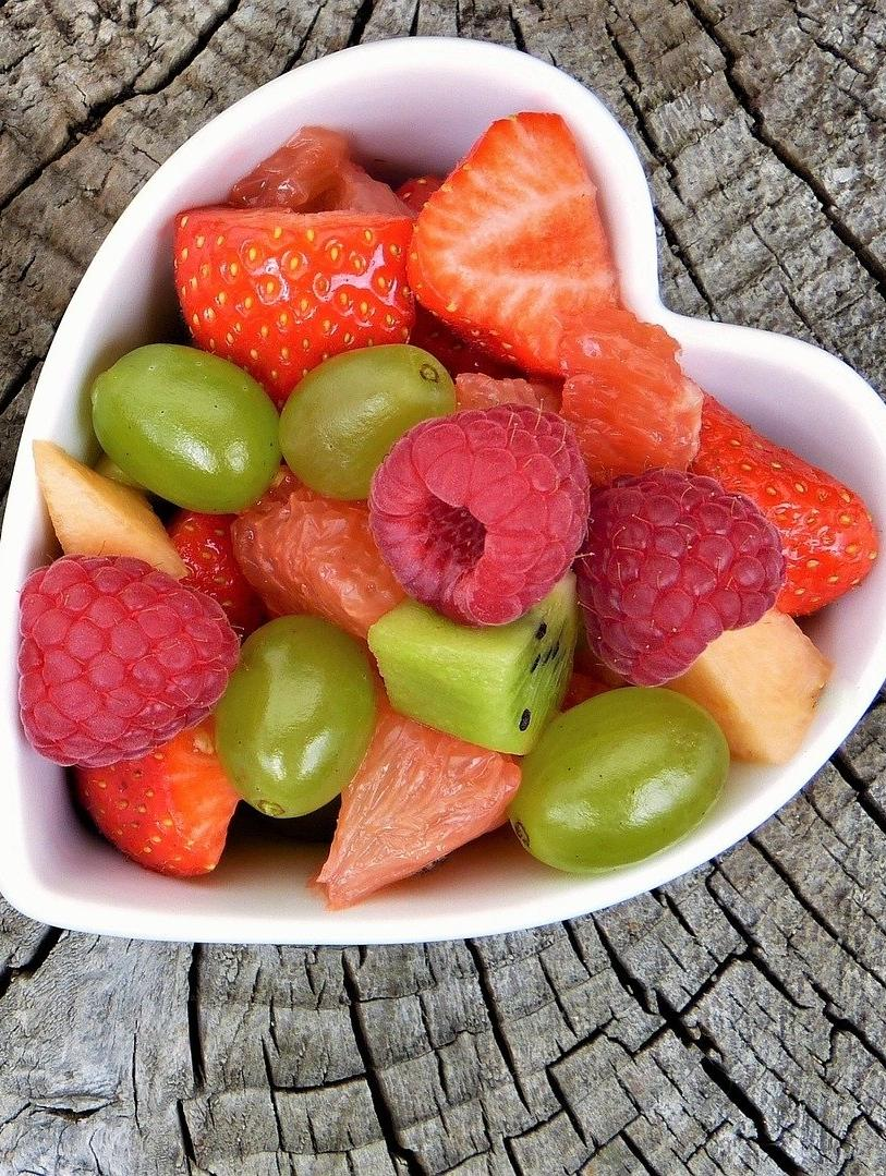 heart shaped bowl of fruit and berries
