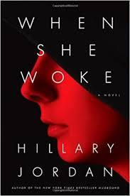 book cover profile of a woman in all red with black draped over he upper face