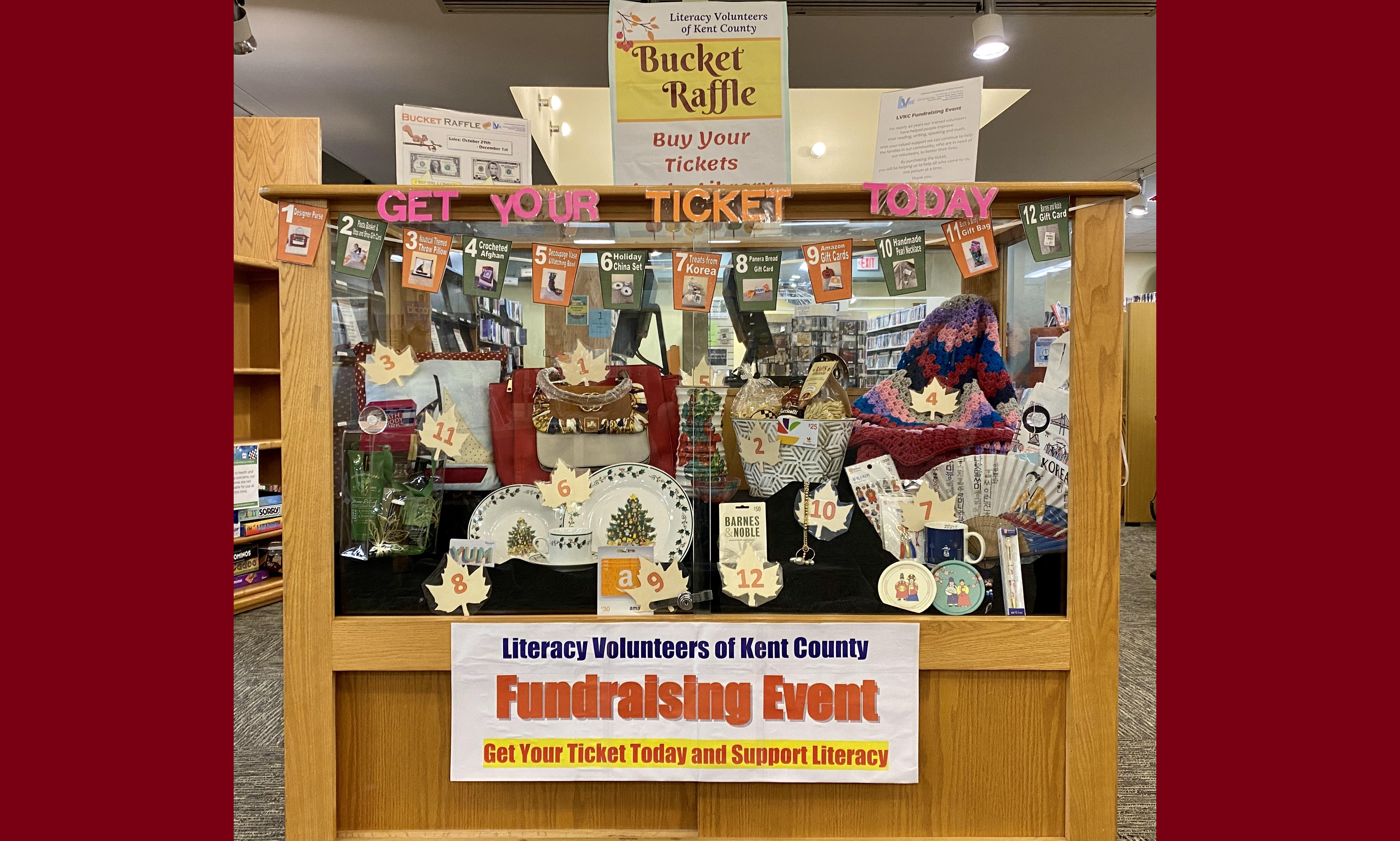 Bucket Raffle items in library display case.
