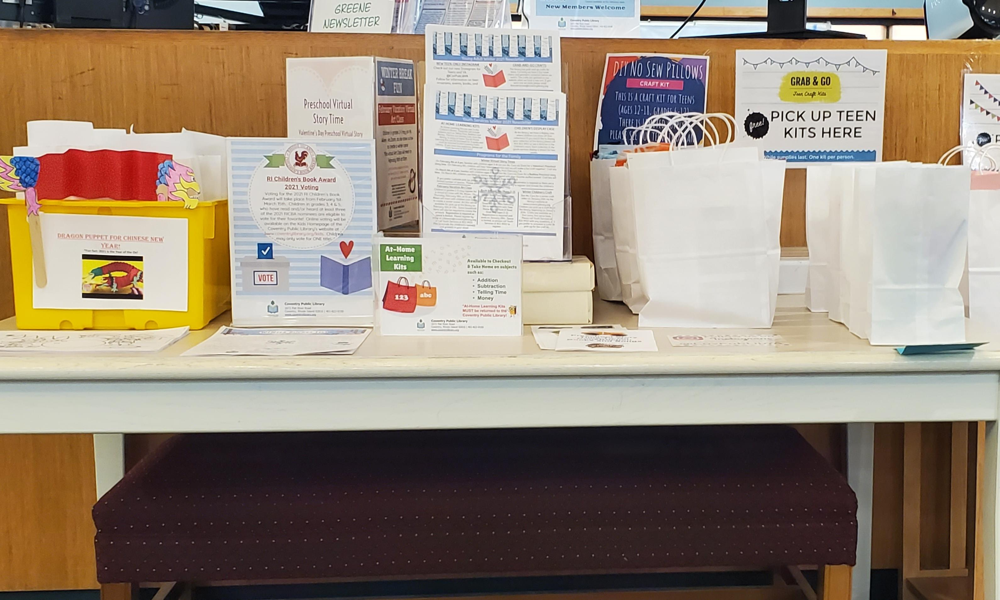 table with bagged crafts and flyers